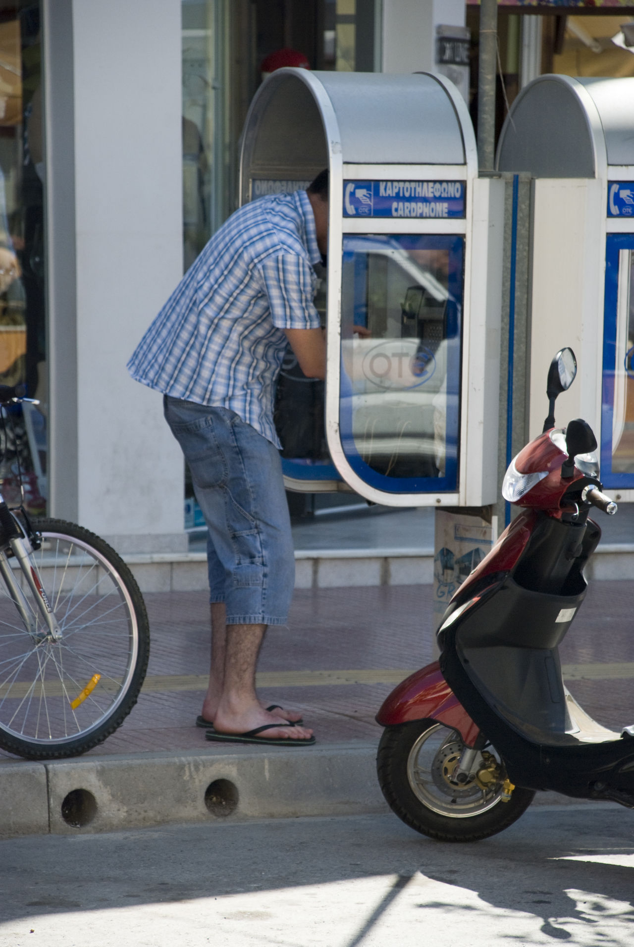 Adult Adults Only Bicycle Casual Clothing Crete Crete Greece Day Full Length Land Vehicle Mode Of Transport One Man Only One Person Open Outdoors People Phone Booth Public Transportation Summer Tall Tall - High Transportation
