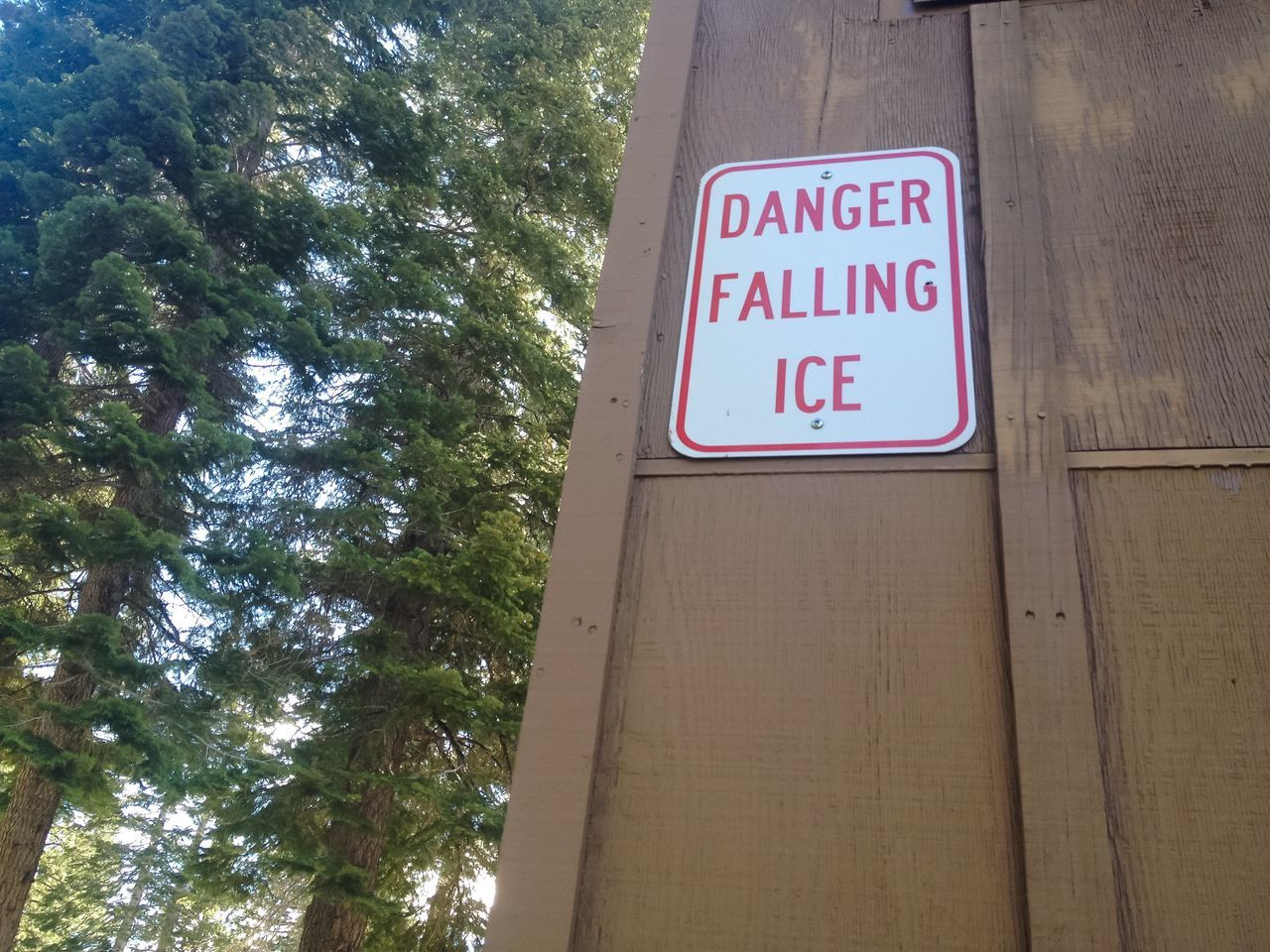 Sign warning of falling ice. Communication Danger Sign Lake Tahoe Mountain Town Pine Tree Sierra Nevada Sierra Nevada Mountains Sign Signs SignSignEverywhereASign Warning Sign