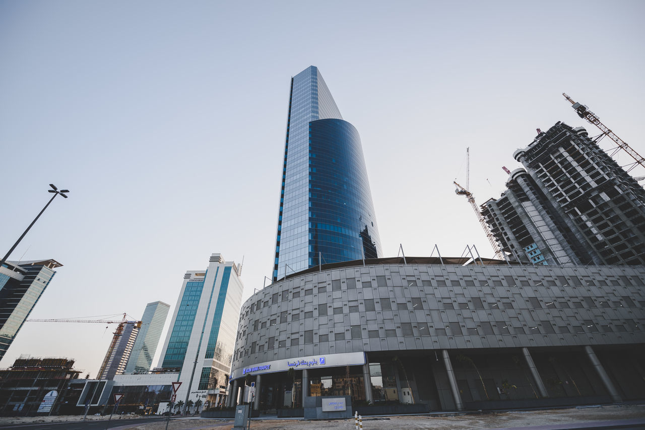Arab Arabian Architecture Building Exterior Built Structure Business Business Finance And Industry City Cityscape Day Downtown District Dubai Financial District  Futuristic Low Angle View Modern No People Office Building Exterior Outdoors Sky Skyscraper UAE United Arab Emirates Urban Skyline