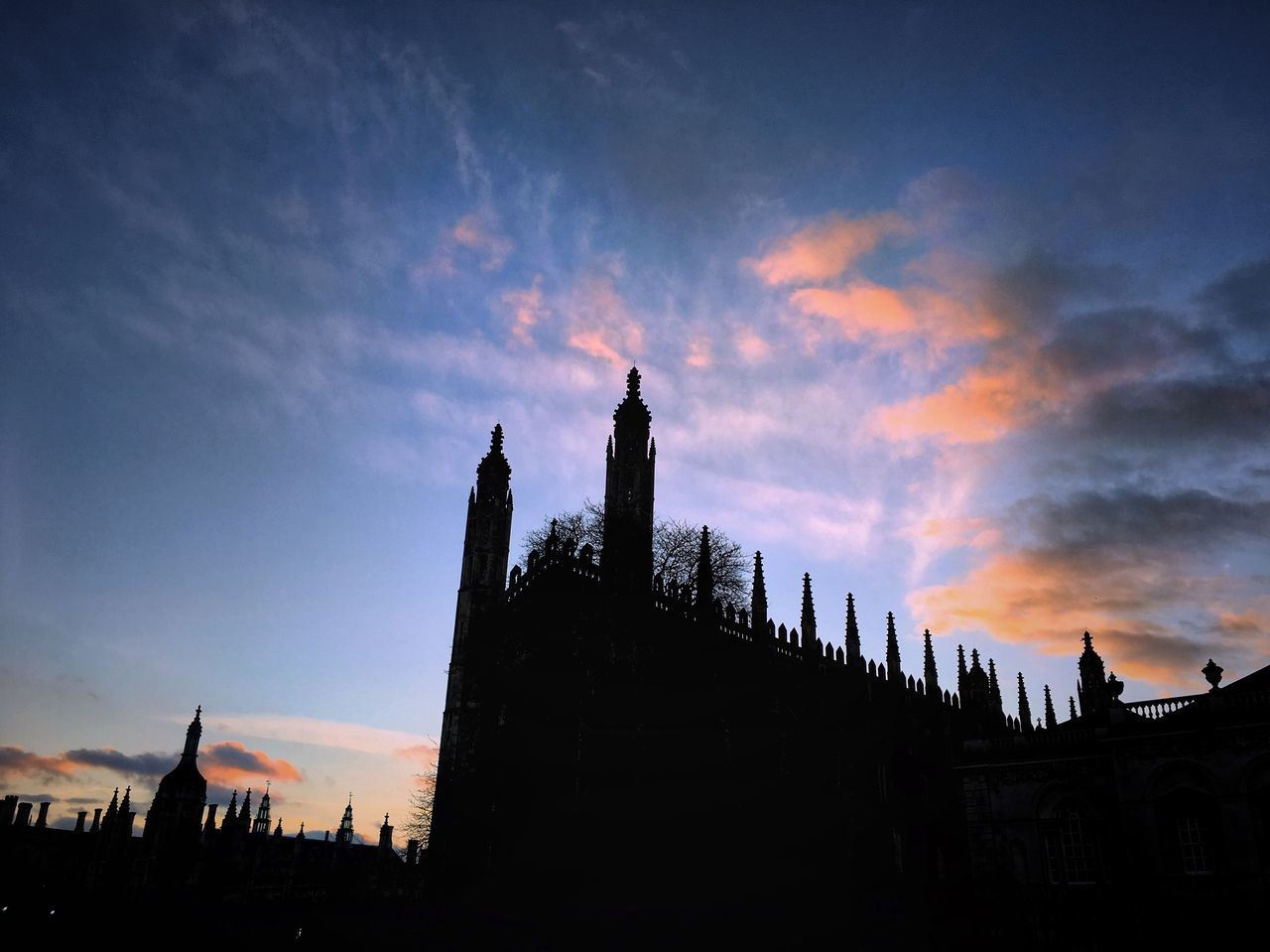 Architecture Sky Built Structure Building Exterior Cloud - Sky Travel Destinations Low Angle View Sunset Outdoors No People Day Kings College Kings College Chapel Kings College Cambridge Cambridge Cambridgeshire Cambridge University Twilight Twilight Sky University Of Cambridge Architecture_collection Mood