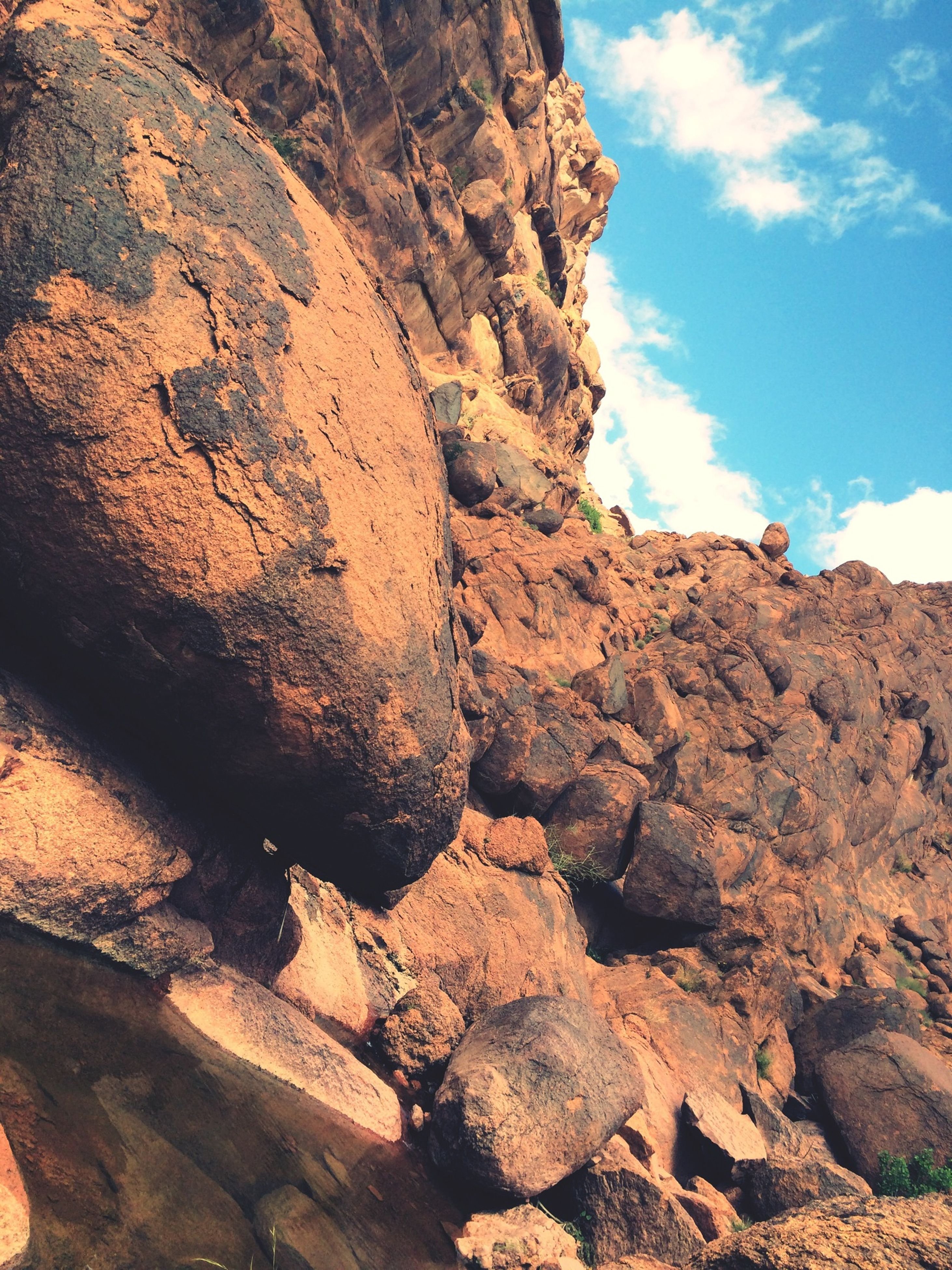 rock formation, rock - object, sky, tranquility, textured, geology, nature, low angle view, rough, rock, tranquil scene, eroded, scenics, beauty in nature, sunlight, physical geography, rocky, day, rocky mountains, cloud