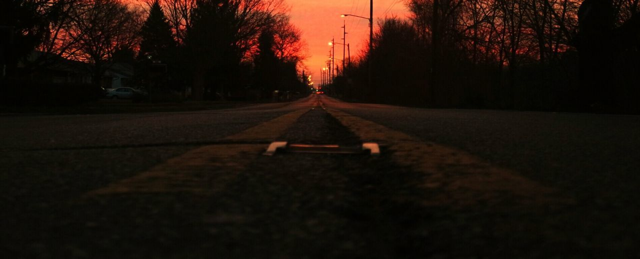 Walking the center line Everybodystreet Centerpoint Centerline Pavement Yellow Line Shadow Light In The Darkness Sunrise_sunsets_aroundworld No Edit EyeEm Gallery Eye4photography  EyeEm Best Shots Ladyphotographerofthemonth Showcase March Eyemphotography EyeEm Best Shots - Nature Pastel Power Pastel Fine Art Photograhy