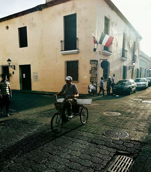 Mode Of Transport Transportation Building Exterior Built Structure Architecture Stationary Bicycle Architecture Colonial Architecture The Caribbean Colonial Style Latin America Meizumx6 Caribbean Colonial Cities Dominican Republic The Street Photographer - 2017 EyeEm Awards Investing In Quality Of Life