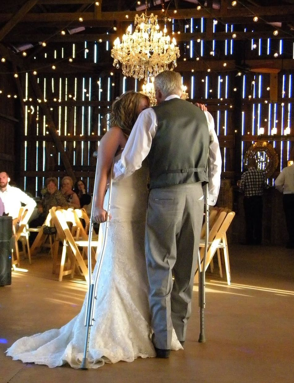 Full Length People Adult Wedding Day Wedding Dance Father Daughter Dance Father Daughter Moments Father Daughter Crutches Dancing With Crutches Slow Dance Uniqueness We Can Do It Yes We Can Daddy's Girl Daddy Daughter Wedding Photography Wedding Reception Wedding