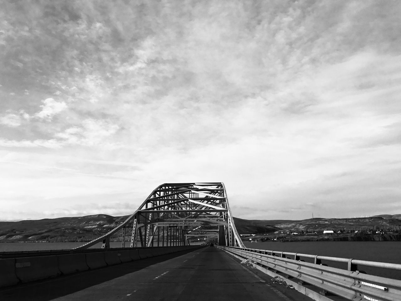 Built Structure Sky Architecture Railing The Way Forward Cloud - Sky Day Outdoors Bridge - Man Made Structure Connection No People Low Angle View Building Exterior Mountain Miles Away Bnw_bridges Allover The World Bnw_friday_eyeemchallenge Travel Suspension Bridge Bridges Bridge Blackandwhite Black And White Landscapes Water