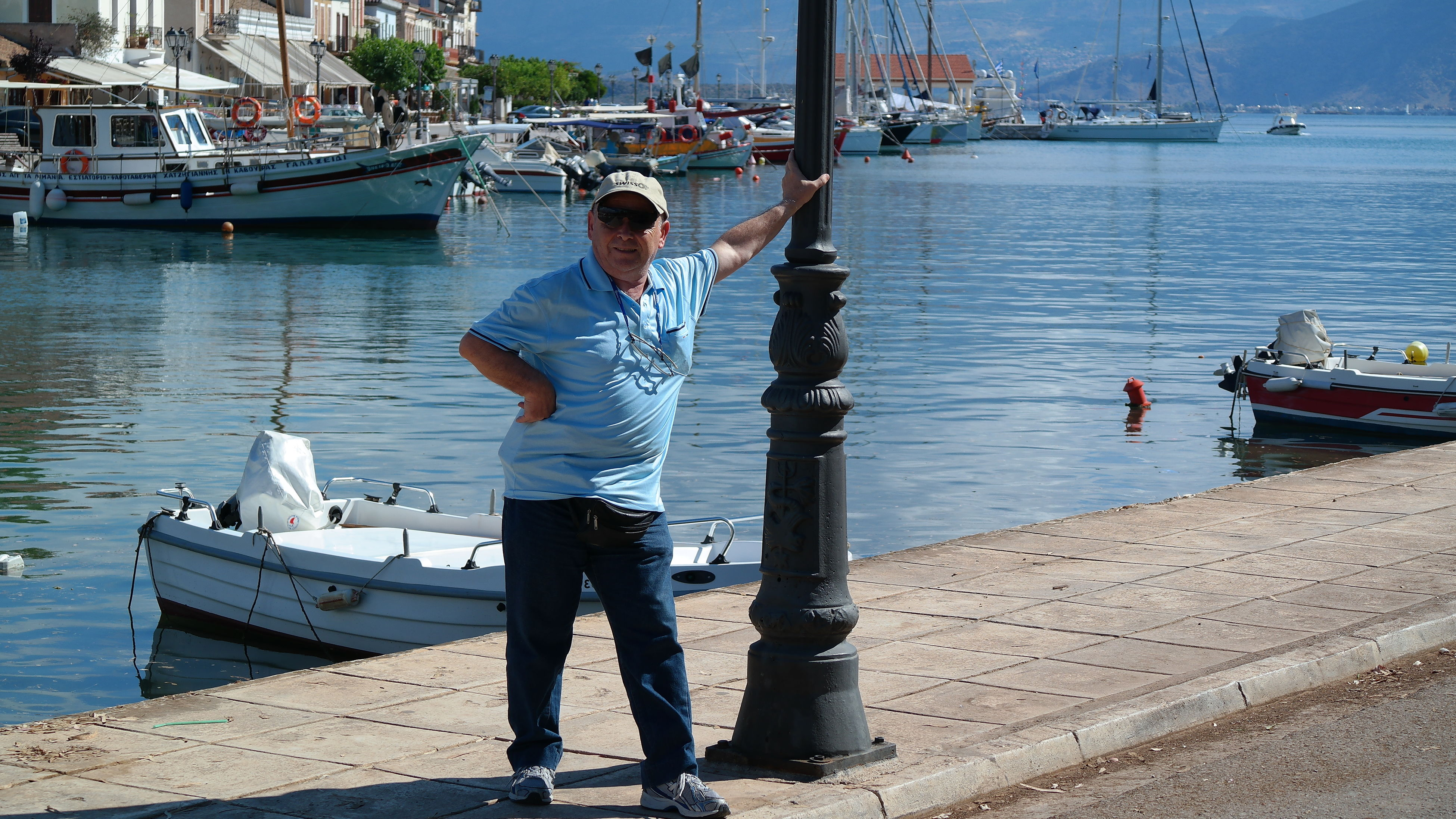 nautical vessel, water, mode of transport, real people, moored, boat, transportation, one person, harbor, full length, day, rear view, casual clothing, standing, men, outdoors, sea, occupation, nature, yacht, sky, young adult