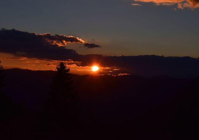 Silhouette Scenics Tranquil Scene Sunset Beauty In Nature Tranquility Mountain Landscape Idyllic Nature Majestic Dark Non-urban Scene Sun Orange Color Outdoors Sky Mountain Range Back Lit Atmosphere
