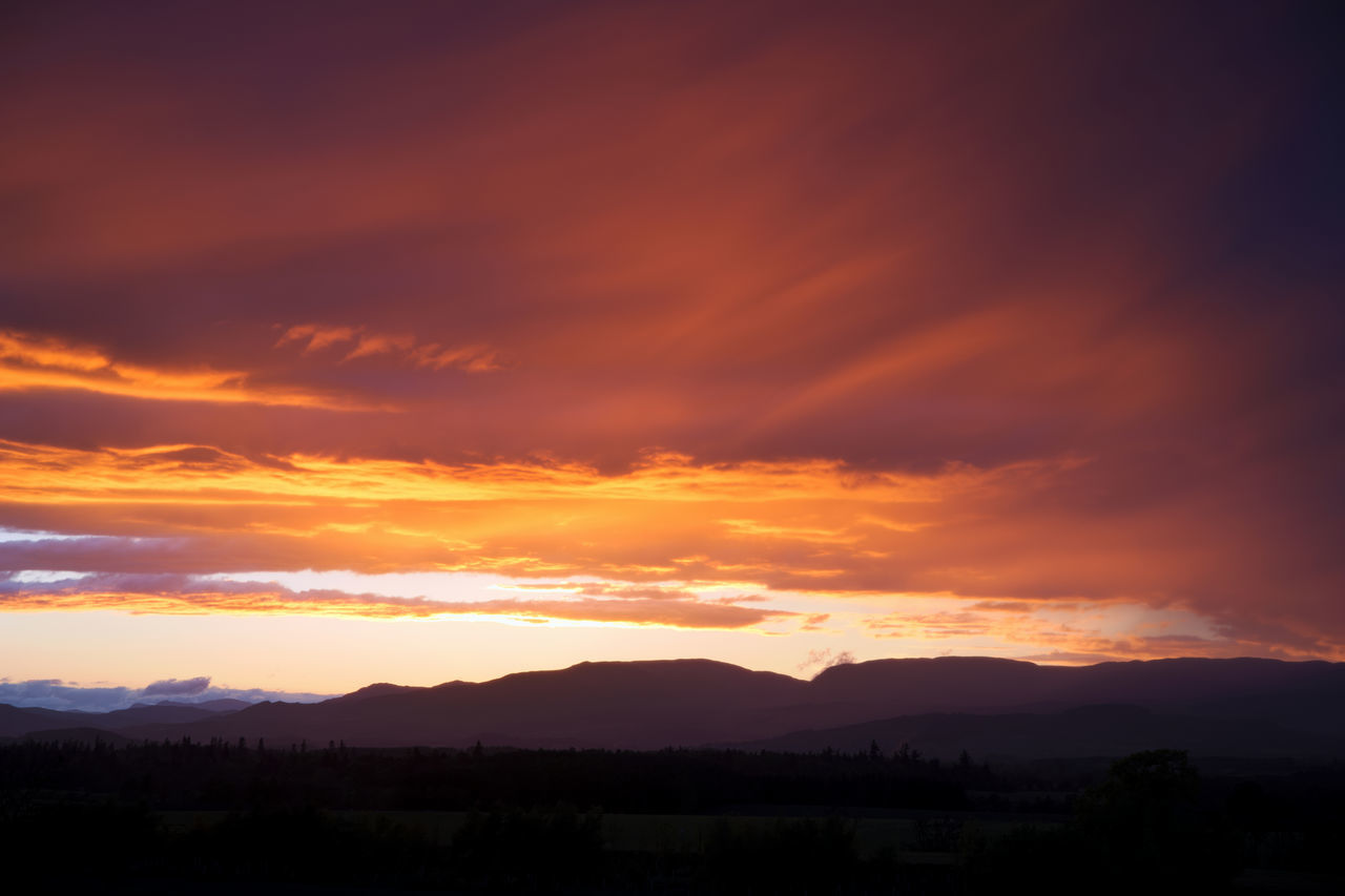 sunset, orange color, tranquil scene, scenics, beauty in nature, silhouette, tranquility, nature, sky, cloud - sky, idyllic, no people, outdoors, landscape, mountain, tree, day