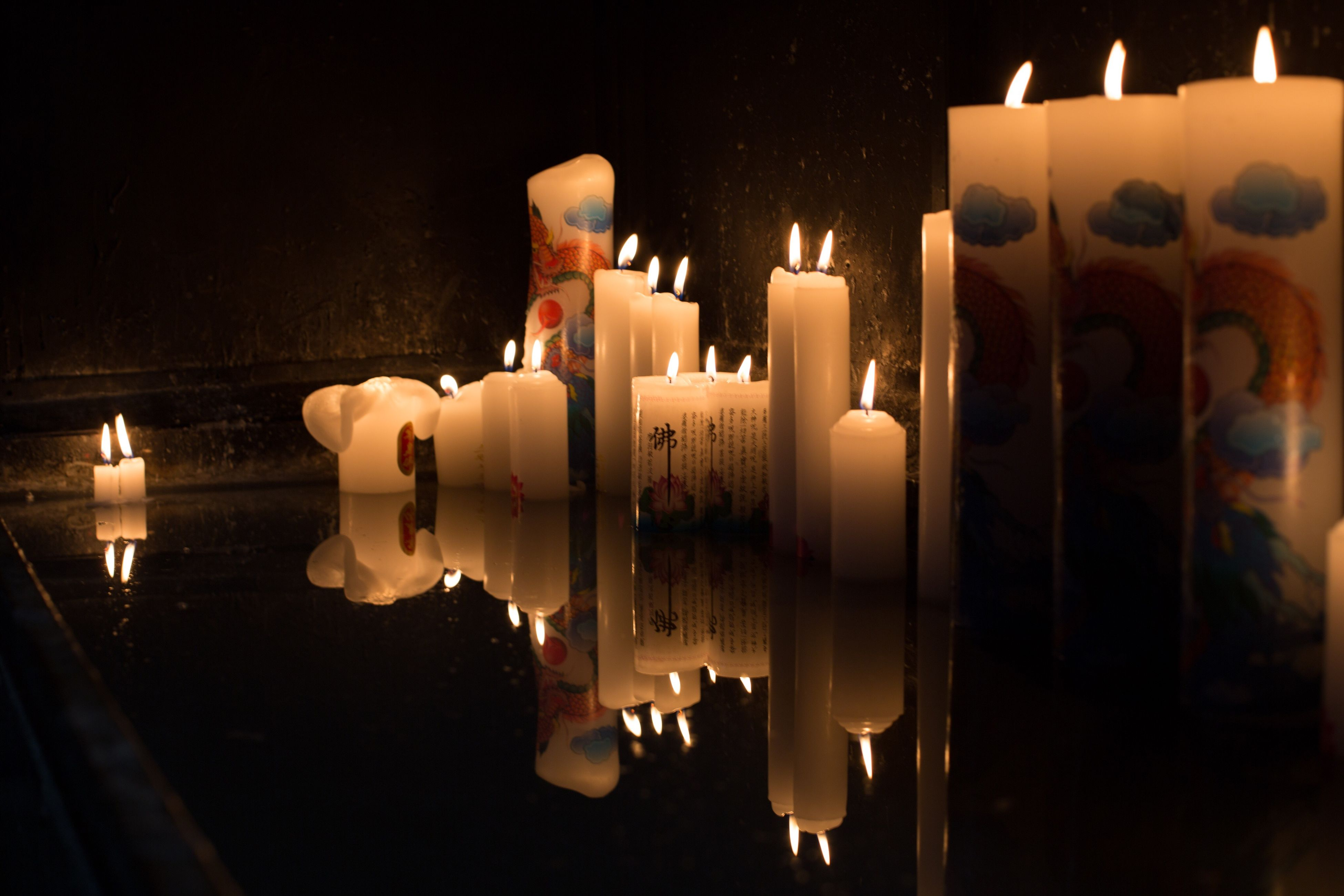 illuminated, flame, burning, candle, close-up, glowing, heat - temperature, lit, large group of objects, in a row, fire - natural phenomenon, repetition, dark, candlelight, decoration, arrangement, man made object