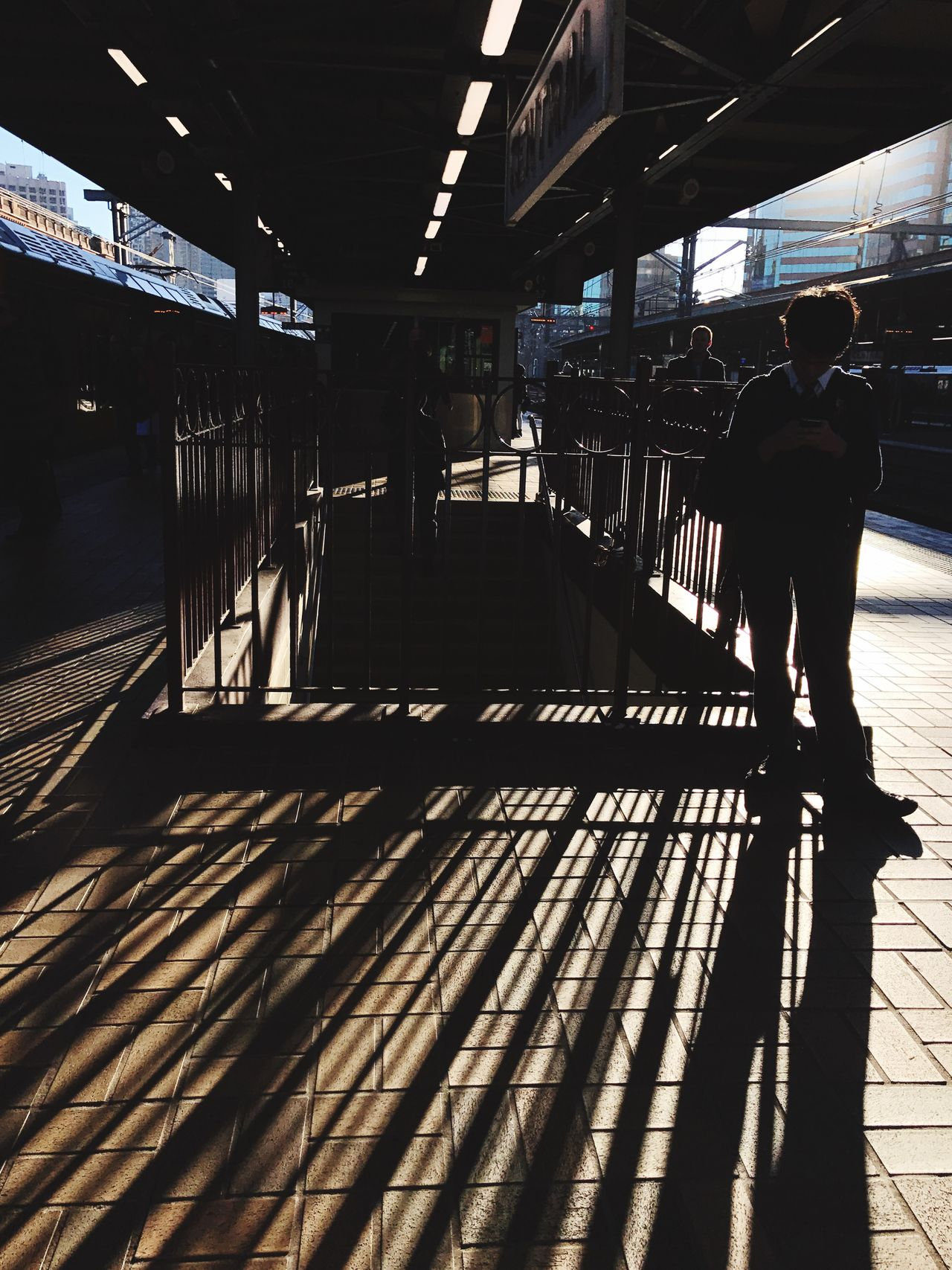 Morning Light | Shadow Sunlight Railroad Station Platform Indoors  Men Lifestyles Day Standing Real People Architecture People