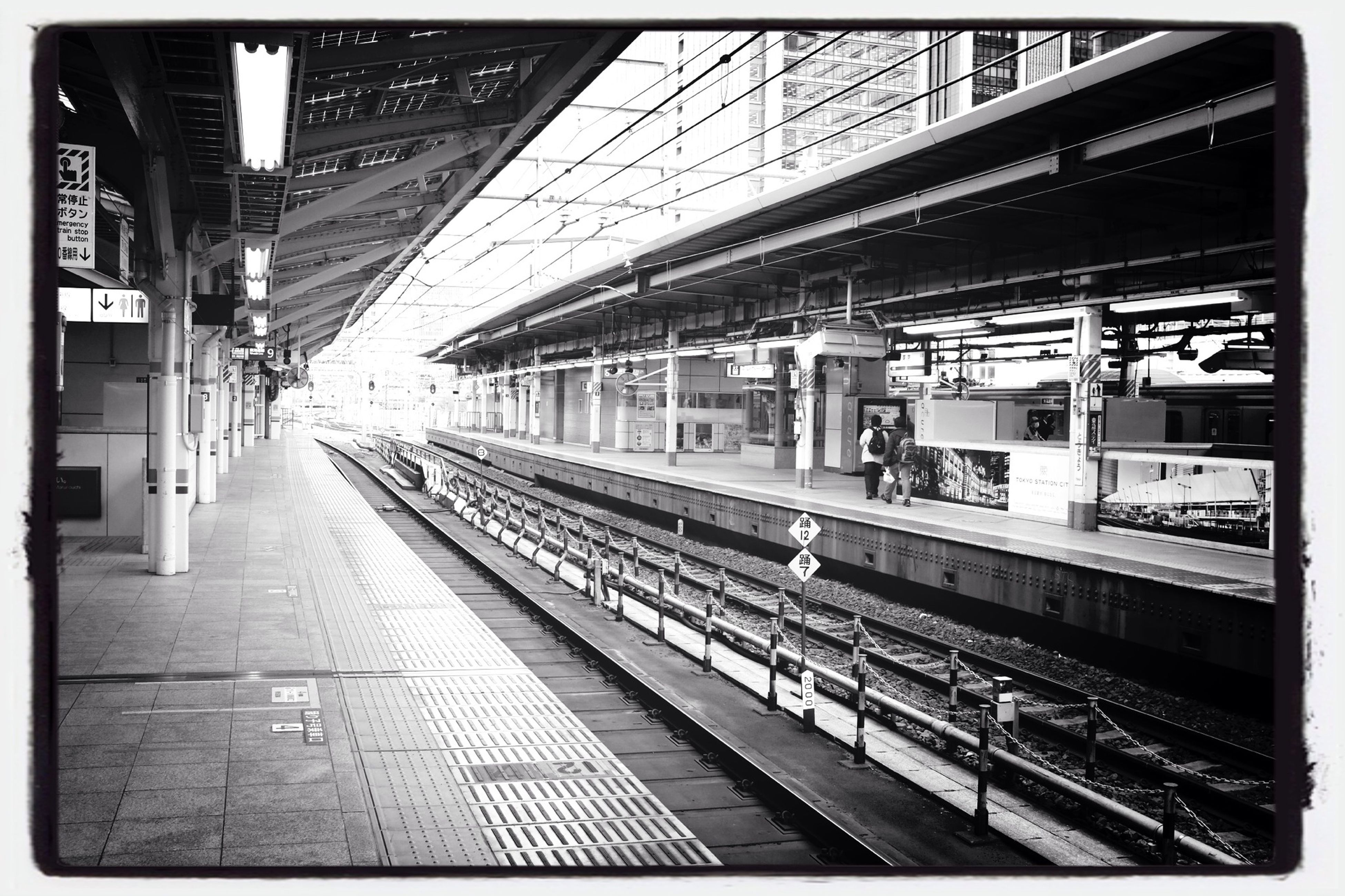 railroad station platform, railroad station, rail transportation, public transportation, railroad track, transportation, transfer print, train - vehicle, architecture, indoors, built structure, travel, passenger train, public transport, subway station, train, men, railway station, person