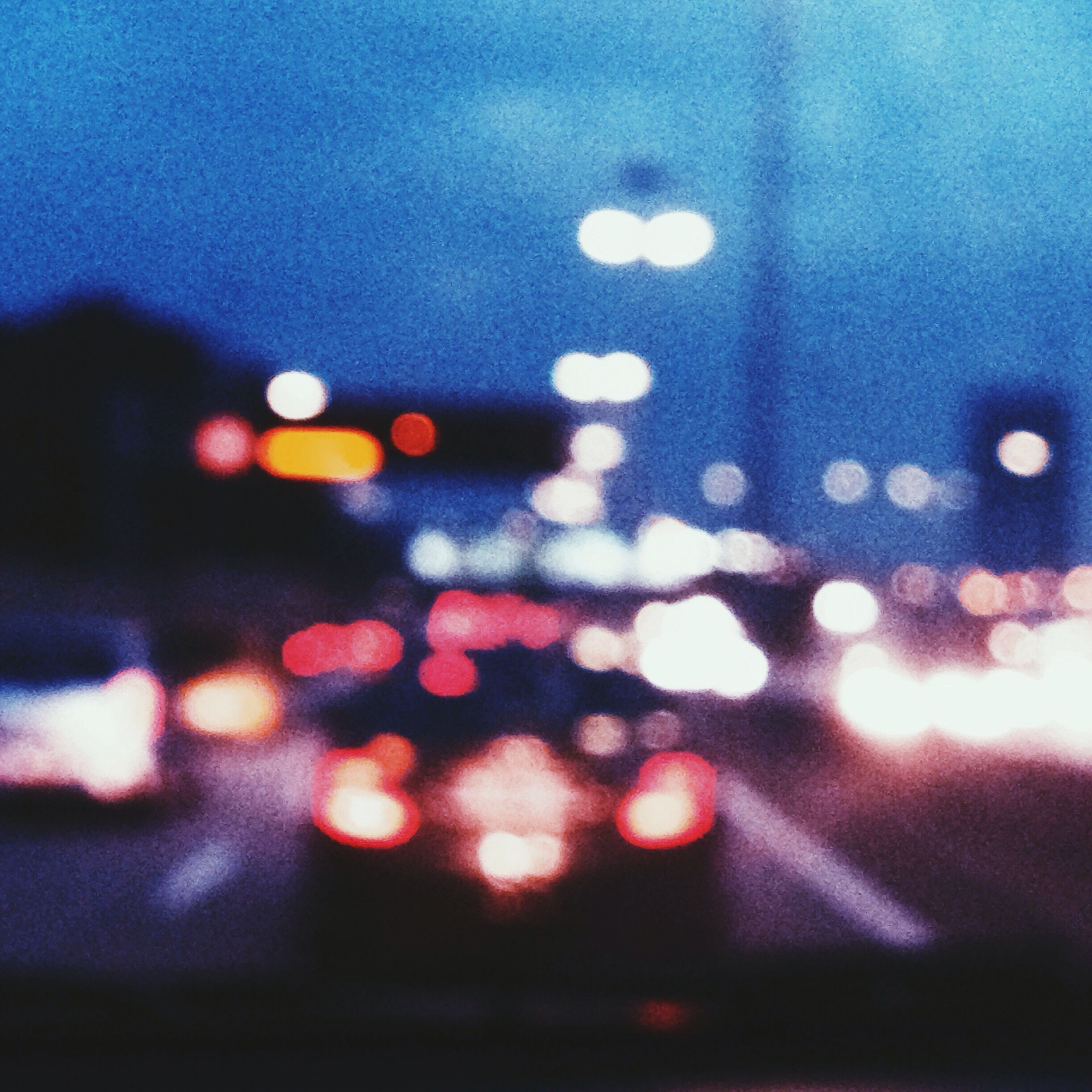 illuminated, defocused, night, light - natural phenomenon, lens flare, transportation, street, lighting equipment, multi colored, sky, road, no people, car, dusk, city, glowing, transparent, light, wet, outdoors