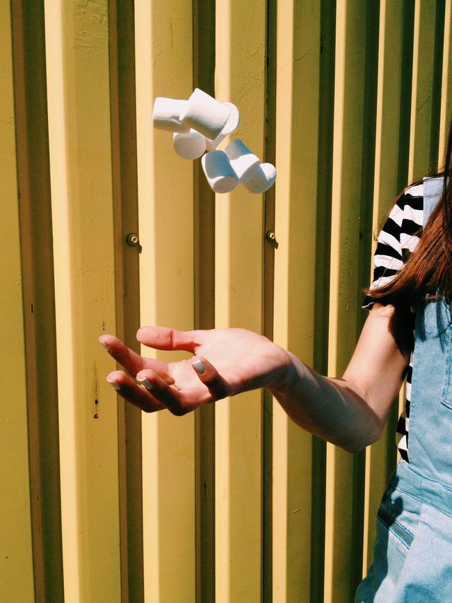 Arm Color Day Hand Leisure Activity Lifestyles Marshmallows Motion On The Fly Outdoors Wall Yellow Color Palette Eyeemphoto