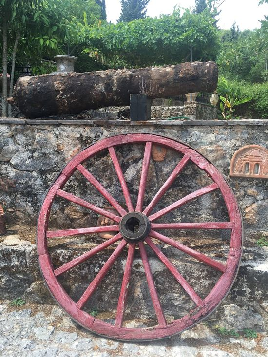 Wheel Transportation Old Tree Rusty Stone Wall Weathered Deterioration The Past Damaged Circle Tranquility Obsolete Outdoors History Day Nature No People