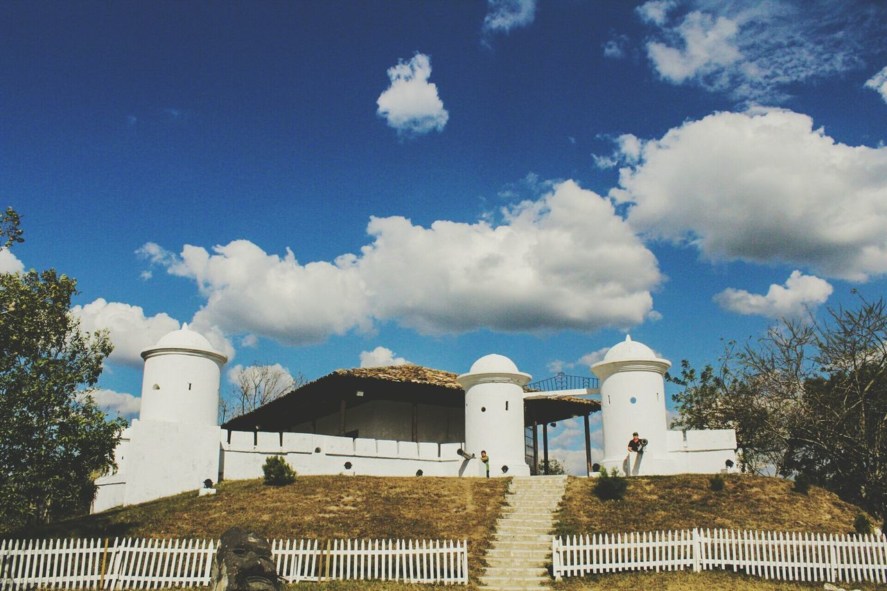 cloud - sky, built structure, architecture, sky, building exterior, day, blue, low angle view, outdoors, tree, no people, nature