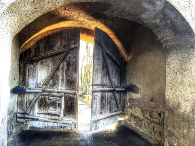 Looking Into The Future Medieval castle gate opening, giving a view in the future behind the doors.