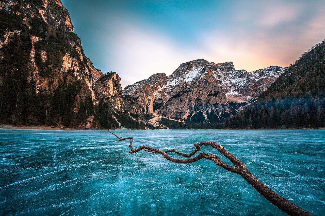 Scenic View Frozen Lake Against Mountain Landscape