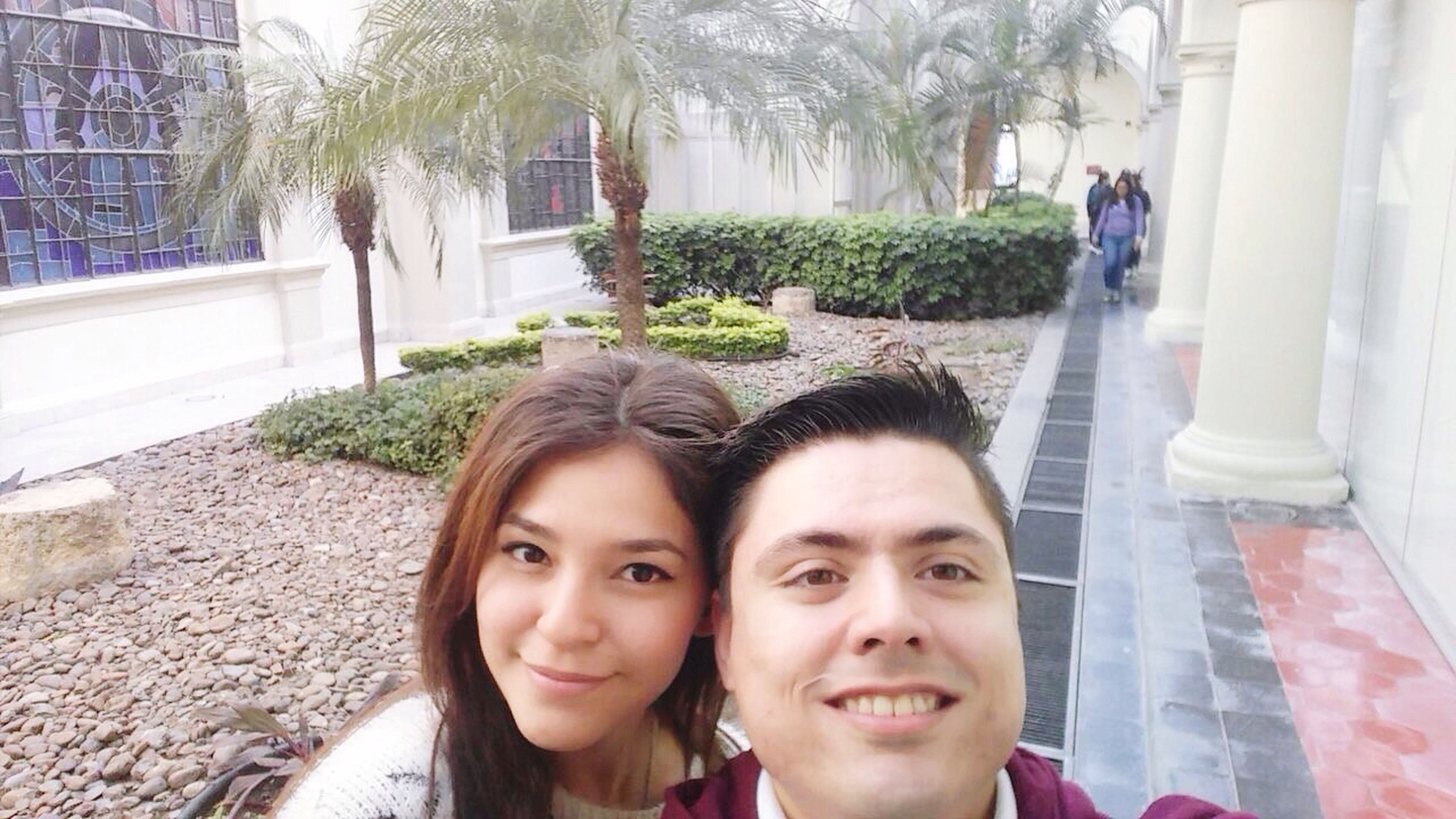two people, looking at camera, real people, portrait, day, young women, smiling, front view, lifestyles, tree, women, young adult, togetherness, building exterior, built structure, outdoors, architecture, adult, people