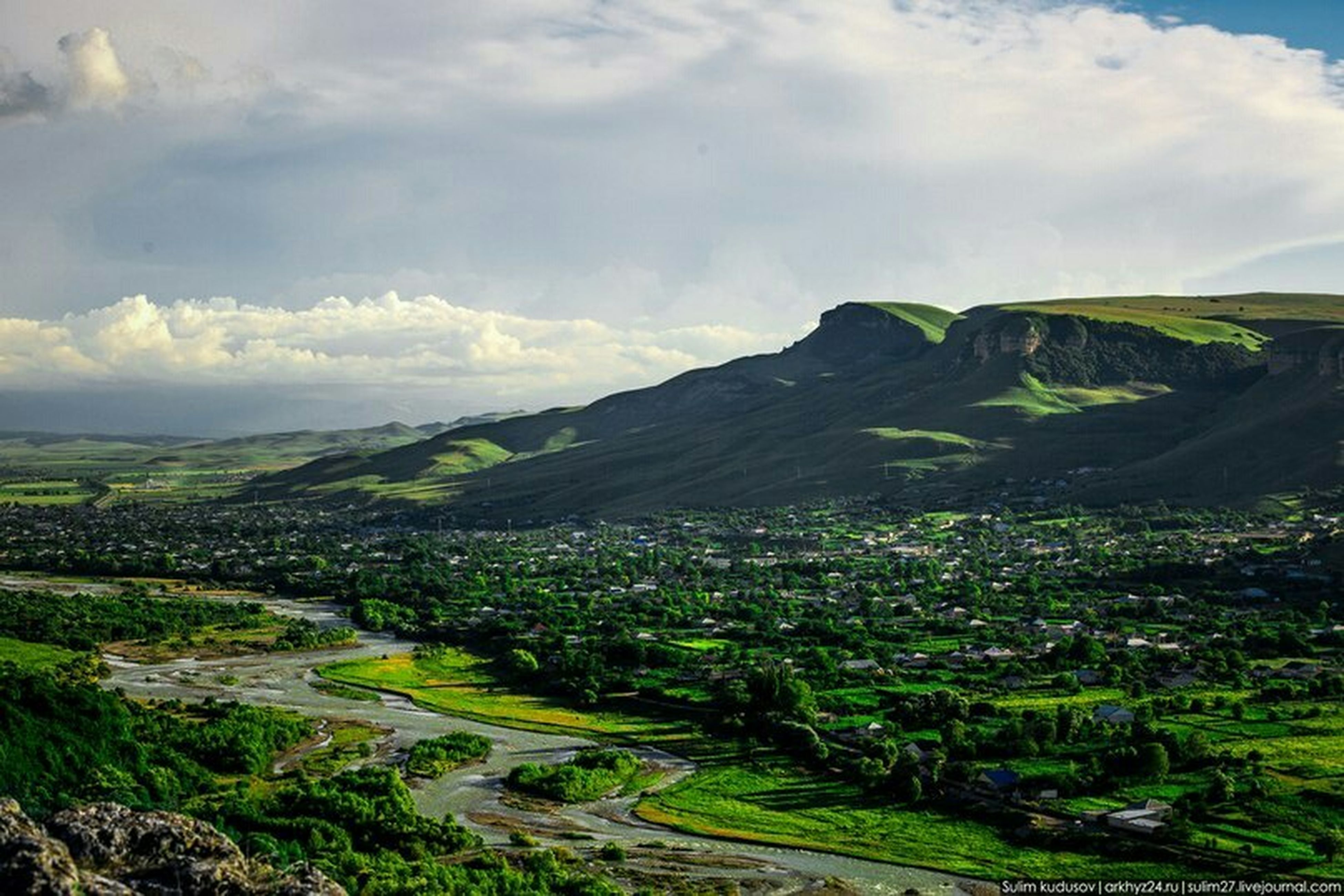 landscape, sky, mountain, high angle view, scenics, cloud - sky, tranquil scene, green color, nature, tranquility, cloud, beauty in nature, agriculture, field, rural scene, tree, cloudy, horizon over land, hill, built structure