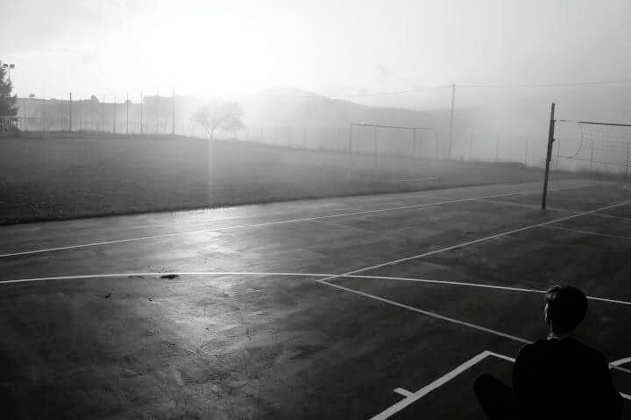 sport, rear view, fog, leisure activity, day, one person, soccer, people, basketball - sport, outdoors, one man only, soccer field, competitive sport, sky, adult, court, adults only, only men