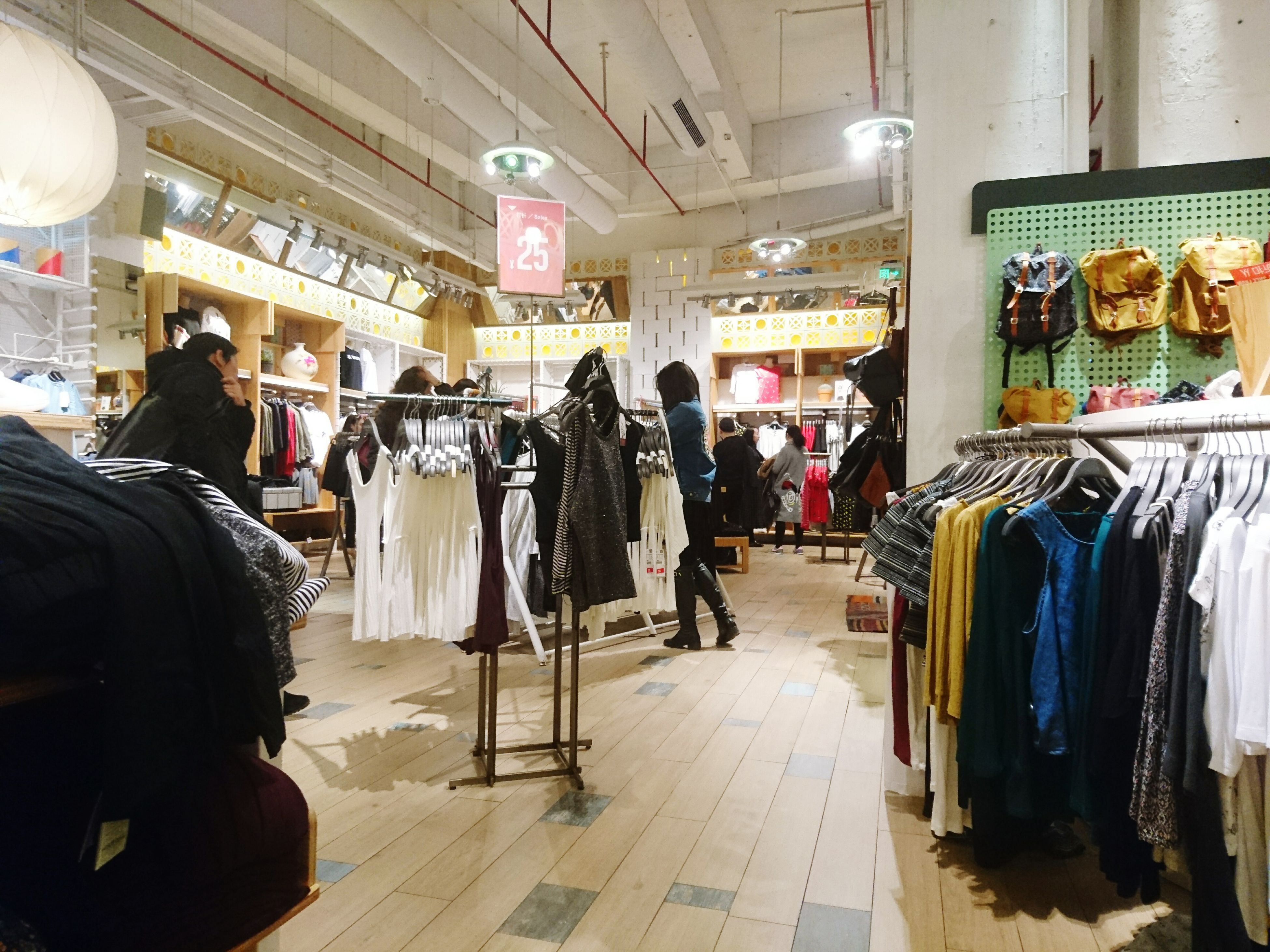 indoors, men, retail, person, lifestyles, market, store, market stall, shopping, for sale, shop, public transportation, leisure activity, casual clothing, transportation, medium group of people, standing, rear view, small business