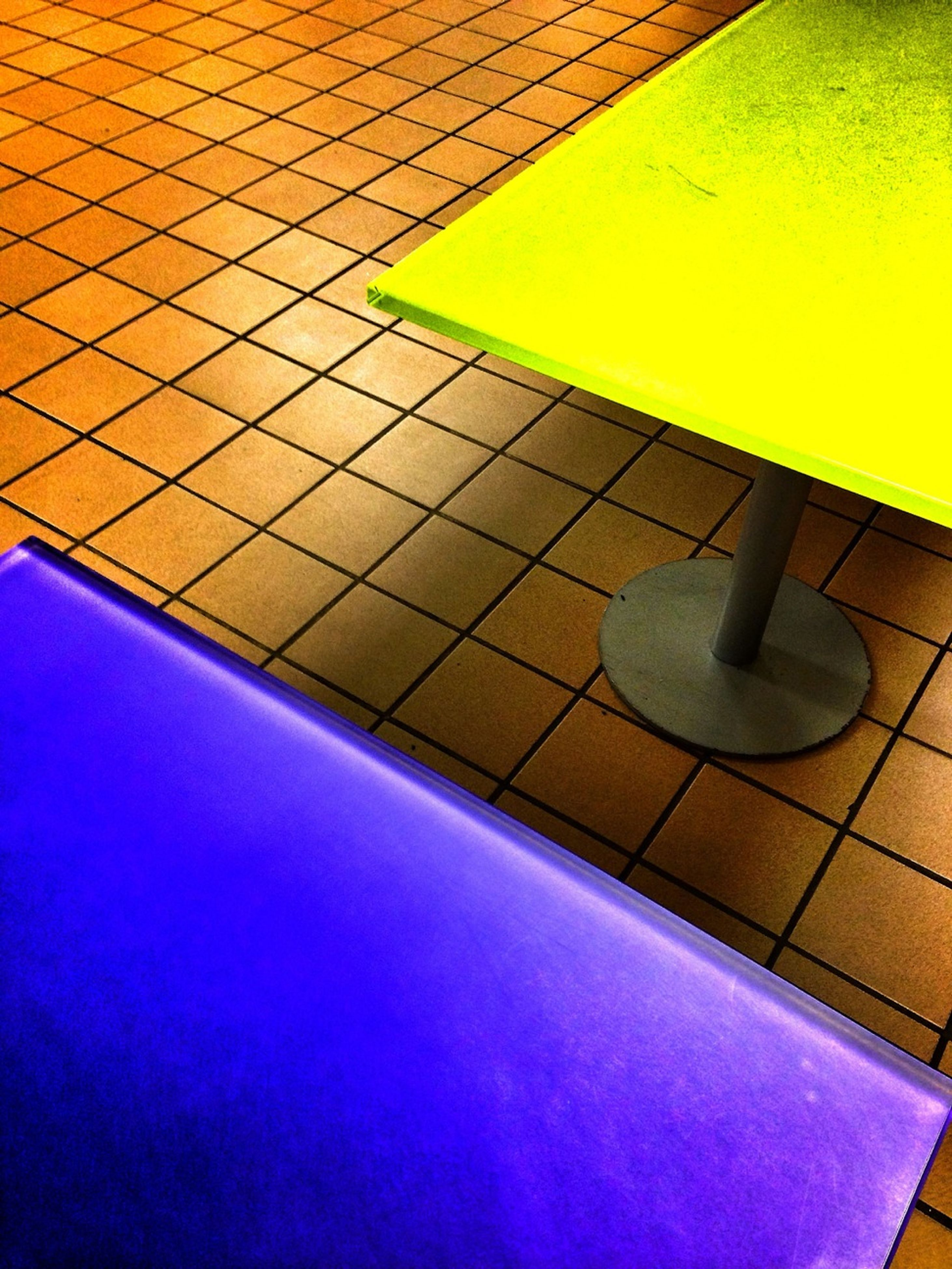 high angle view, blue, pattern, built structure, architecture, shadow, yellow, swimming pool, tile, building exterior, multi colored, indoors, tiled floor, no people, day, wall - building feature, sunlight, empty, geometric shape