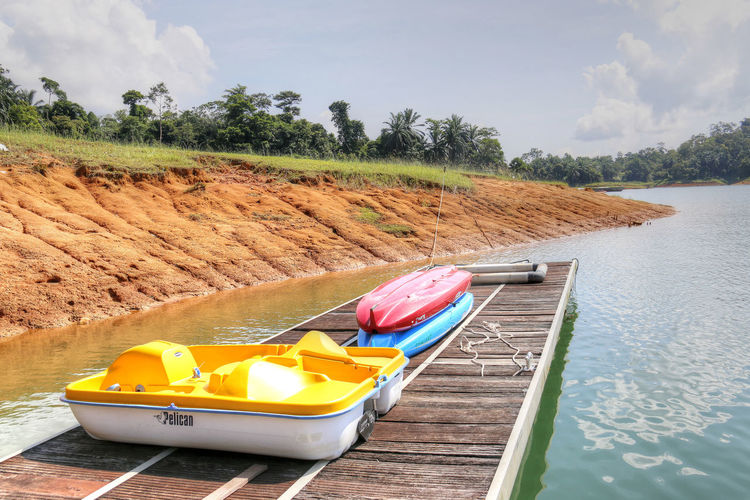 Water Tropical Paradise Tropical Jungle Tropical Tranquility Terengganu Sky Scenics Outdoors No People Nature Malaysia Lake Kenyir Lake' Kenyir Beauty In Nature Kenyir Lake Tourist Destination Lakeside Nautical Vessel Boat Grass Boats