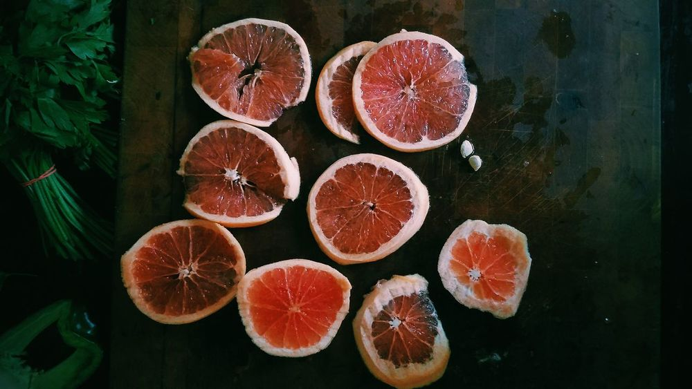 Grapefruit No People Indoors  Healthy Eating Fruit Day Freshness Close-up Blood Orange Kitchen Table High Angle View EyeEmNewHere Food Colors Cutting Board