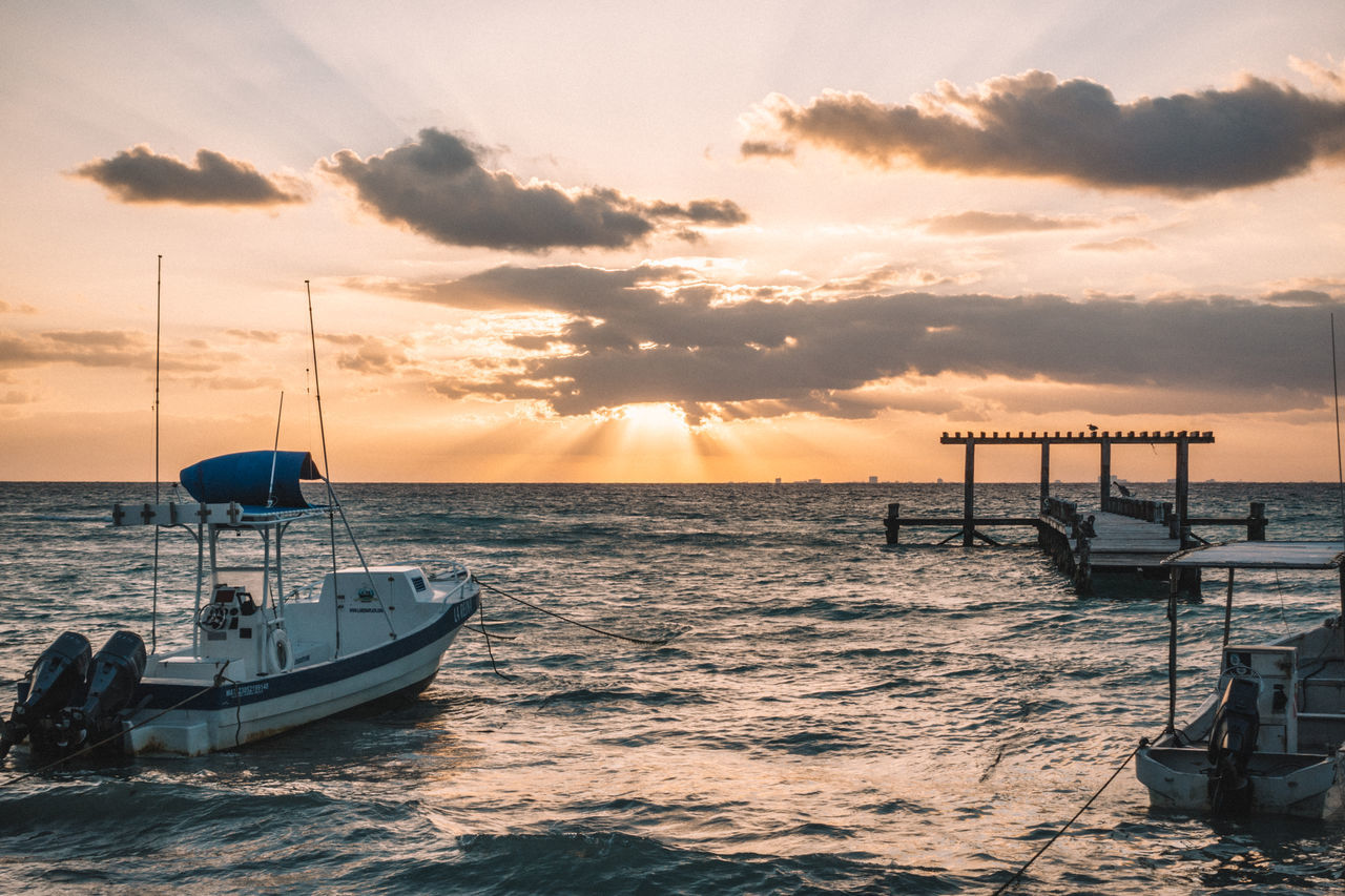 sunset, sea, nautical vessel, sky, water, nature, beauty in nature, mode of transport, transportation, cloud - sky, scenics, moored, no people, outdoors, horizon over water, beach, mast, outrigger, day