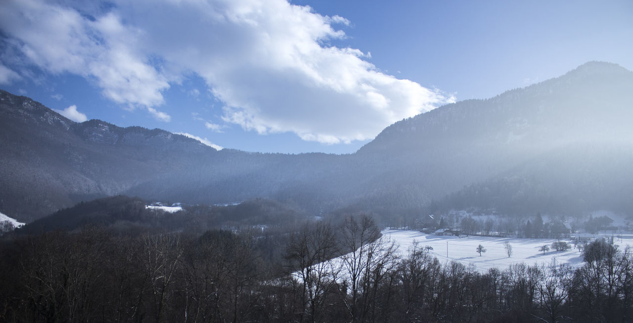 Low Angle View Of Mountains Against Sky During Winter