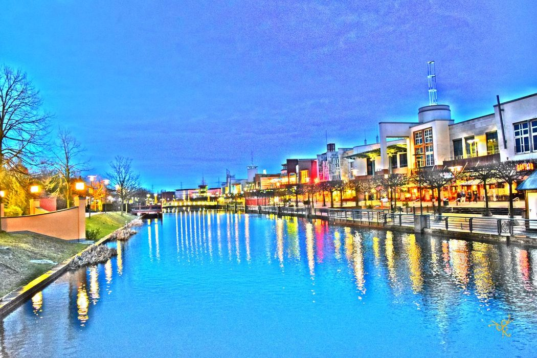 Architecture Blue Building Exterior Built Structure Canal Centro Oberhausen Clear Sky Gasometer Oberhausen Incidental People Oberhausen Reflection River Sky Transportation Travel Travel Destinations Water Waterfront