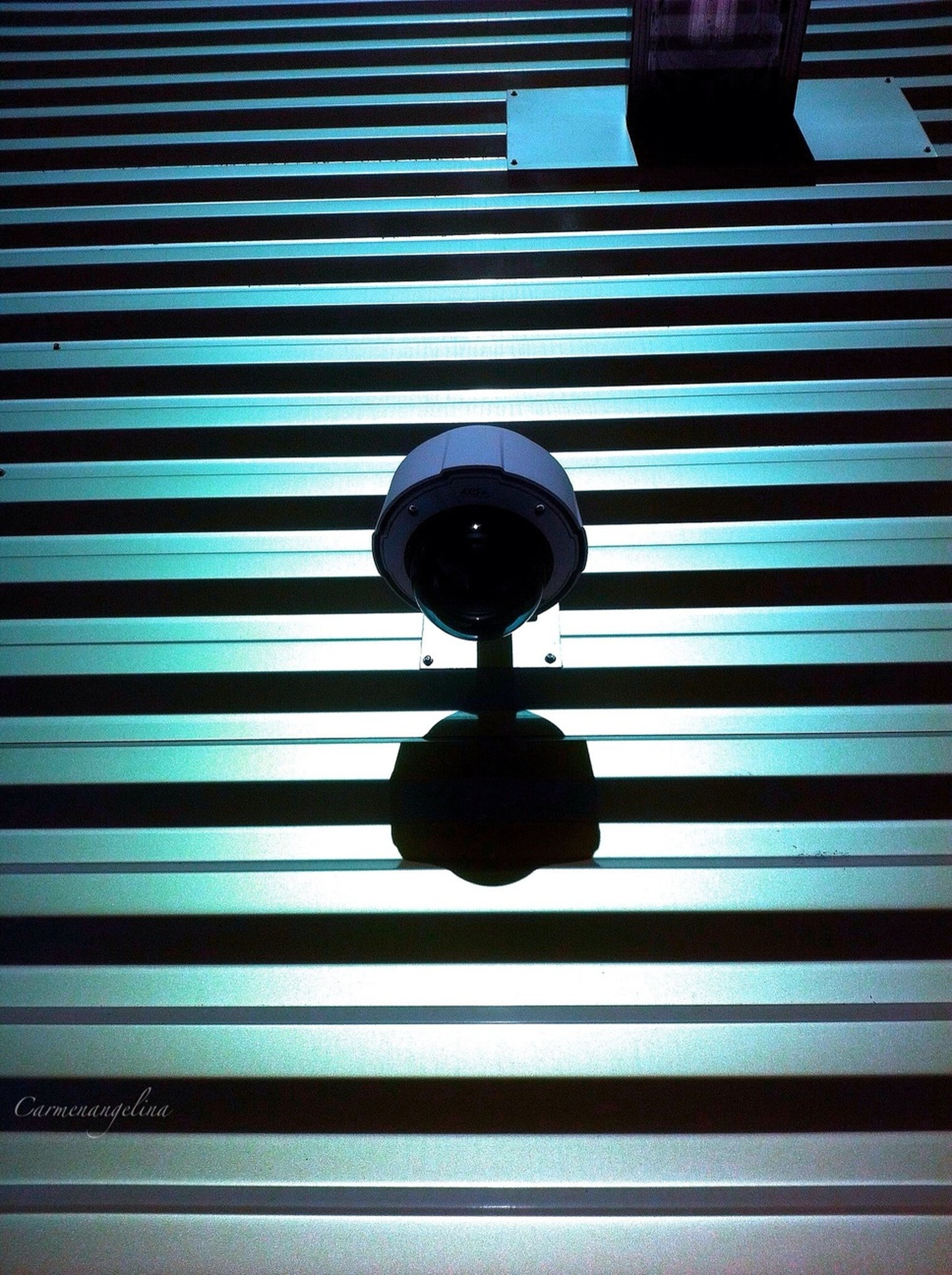 architecture, built structure, building exterior, low angle view, lighting equipment, pattern, window, modern, blue, railing, indoors, building, no people, circle, wall - building feature, illuminated, metal, glass - material, day