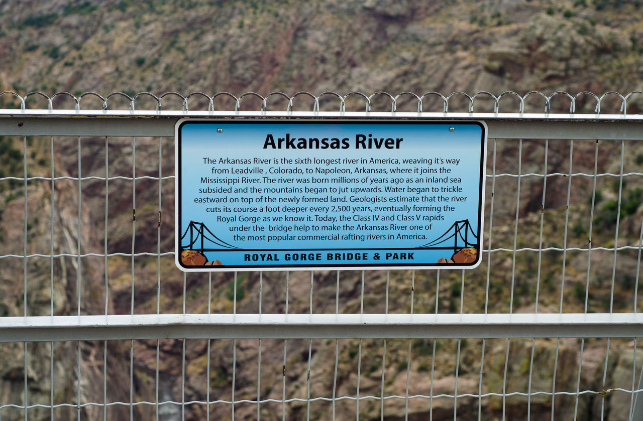 Arkansas River Blue Close-up Communication Day Focus On Foreground Geometric Shape Guidance Information Sign Journey Non-urban Scene Non-western Script Outdoors Public Transport Royal Gorge Bridge, Colorado Subway Station Symbol Text Western Script