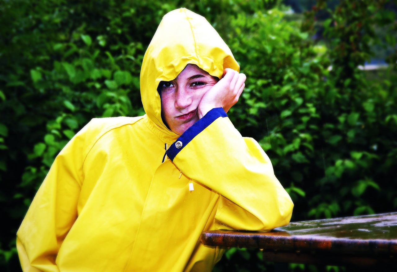 Girl on a bad weather day Girl Raincoat Woman Weather Frustration Funny View Face Portrait Rain Rain Drops Jacket Yellowstones Beauty Vacation Disappointed Burnout Ill Influence Health Illness Teenager Depression Problems Depressive
