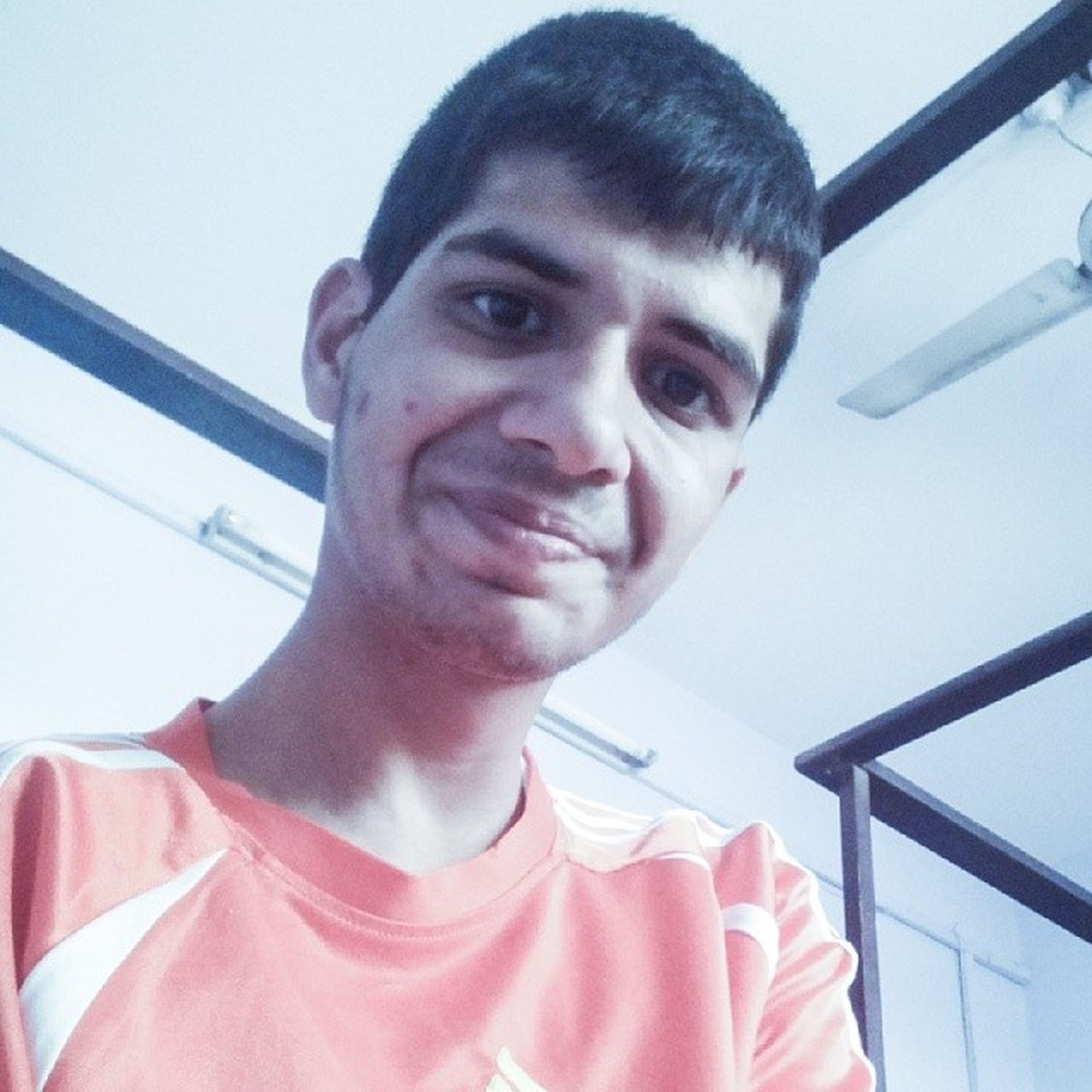 person, looking at camera, portrait, lifestyles, front view, low angle view, headshot, casual clothing, smiling, young adult, leisure activity, childhood, indoors, young men, waist up, close-up, day