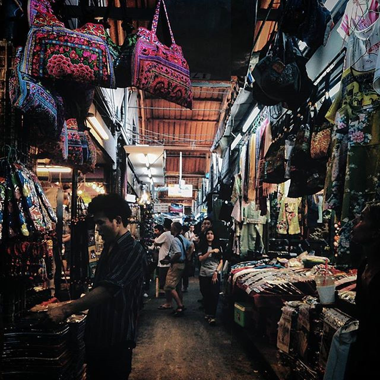 market, store, retail, building exterior, market stall, architecture, real people, street, city, consumerism, choice, men, customer, lifestyles, built structure, night, outdoors, women, adult, people, adults only