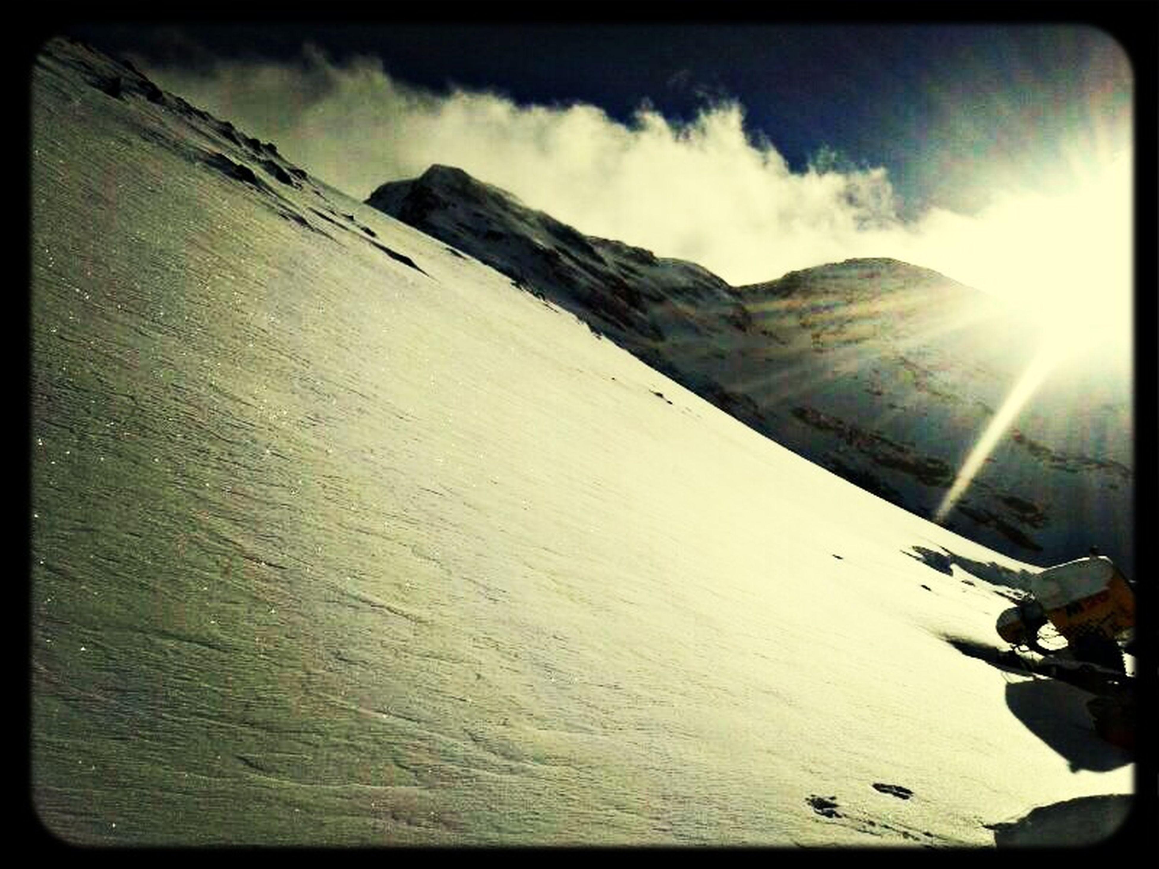 transfer print, mountain, sky, sun, tranquil scene, sunbeam, sunlight, mountain range, beauty in nature, landscape, tranquility, scenics, auto post production filter, nature, snow, cloud, panoramic, cloud - sky, lens flare, non-urban scene