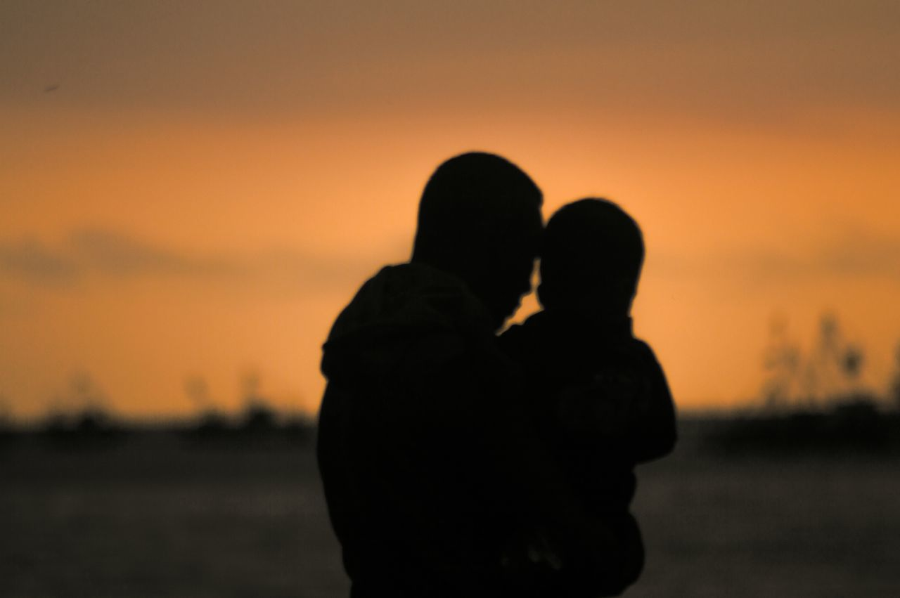 Numpang foto satu lagi. (father and son).. Silhouette Sunset Sunset Silhouettes Sunset_collection Light And Shadow Shadow Beach Creative Light And Shadow Life Is A Beach On The Beach People People Photography Streetphotography Showcase: January Snapshots Of Life Getting Inspired Sound Of Life Light