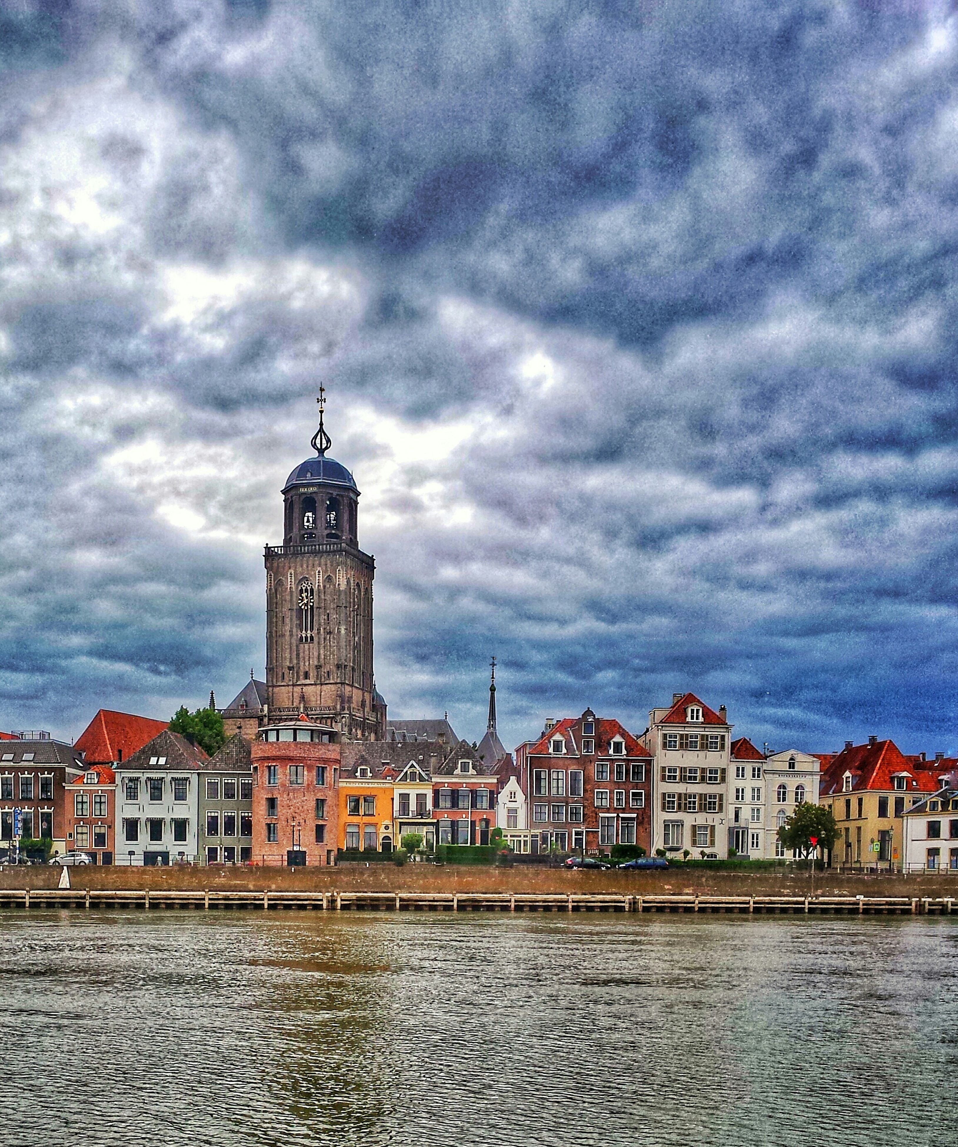 architecture, building exterior, built structure, sky, cloud - sky, water, cloudy, waterfront, weather, cloud, overcast, river, storm cloud, city, residential structure, rippled, residential building, day, outdoors, building