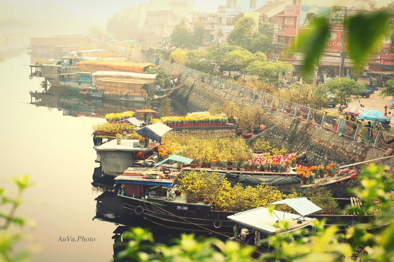 These are the boats from the countrysides coming to the city to transport flowers for Lunar New Year. This is the Ben Binh Dong flower Market. Built Structure Outdoors Nature Day Sky People Boat Flowers ByAuVu Vietnamnewyear
