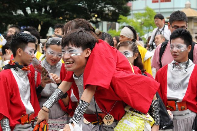 Two performers at the traditional dance festival; Yoyogi park, Tokyo, Japan, enjoying themselves whilst they wait to go on stage. Crowd Crowded Culture Enjoyment Event Festival Focus On Foreground Fun Japan Laughing Lifestyles Mask - Disguise Person Photojournalism Red Selective Focus Smile Streetphotography Tokyo