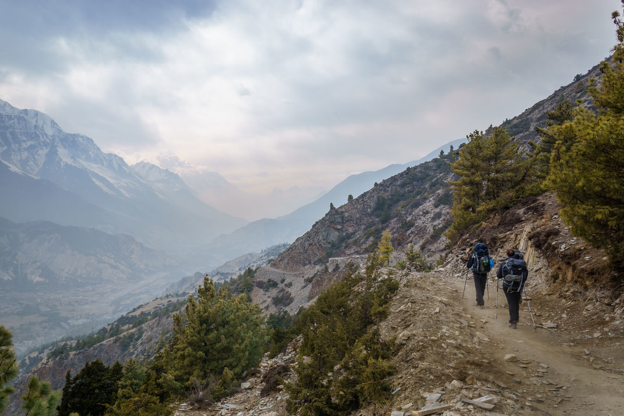 Adventure Annapurna Circuit Backpack Climbing Cloud - Sky Day Exploration Full Length Hiker Hiking Leisure Activity Lifestyles Men Mountain Mountain Range Nature Outdoors Real People Rear View Scenics Sky Standing Togetherness Two People Walking