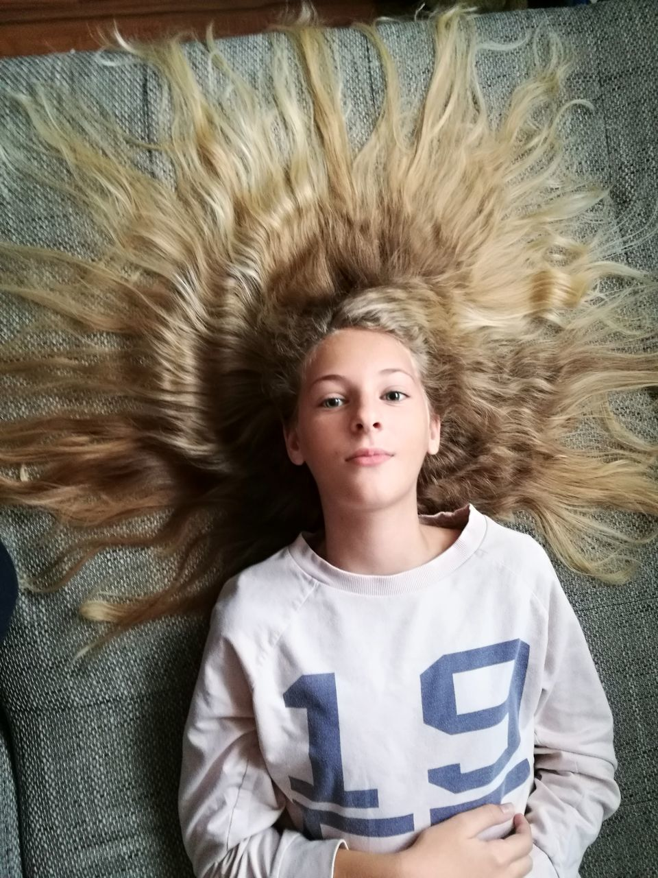 Portrait Of Girl With Hair Spread On Bed