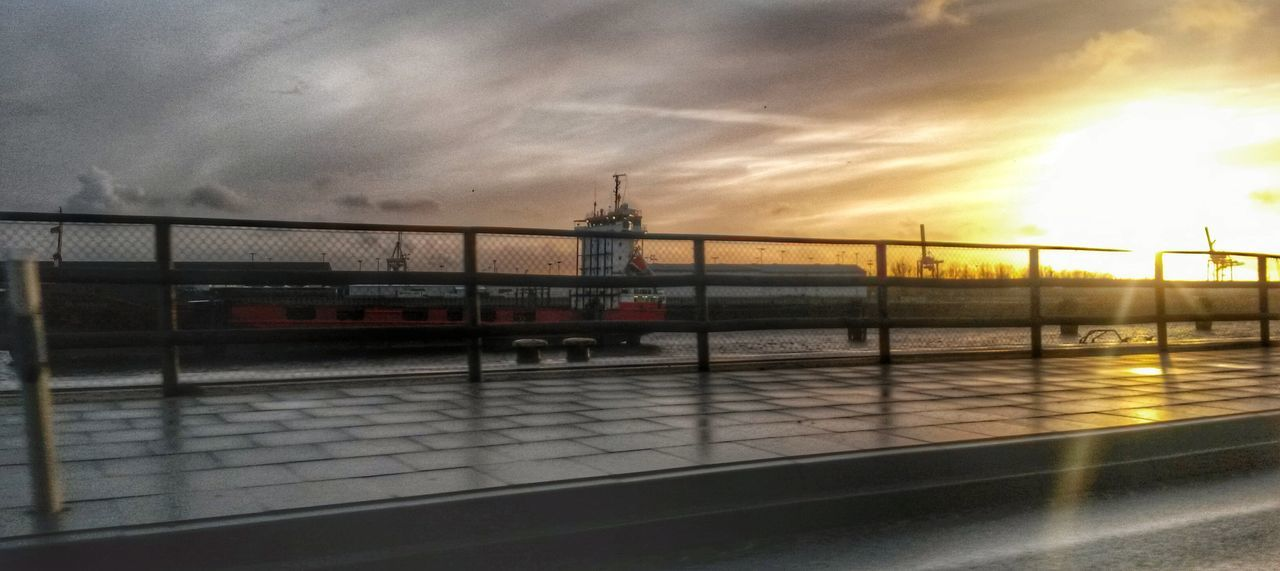 sky, sunset, architecture, cloud - sky, transportation, built structure, water, mode of transport, bridge - man made structure, building exterior, no people, outdoors, travel destinations, sea, nautical vessel, day, nature