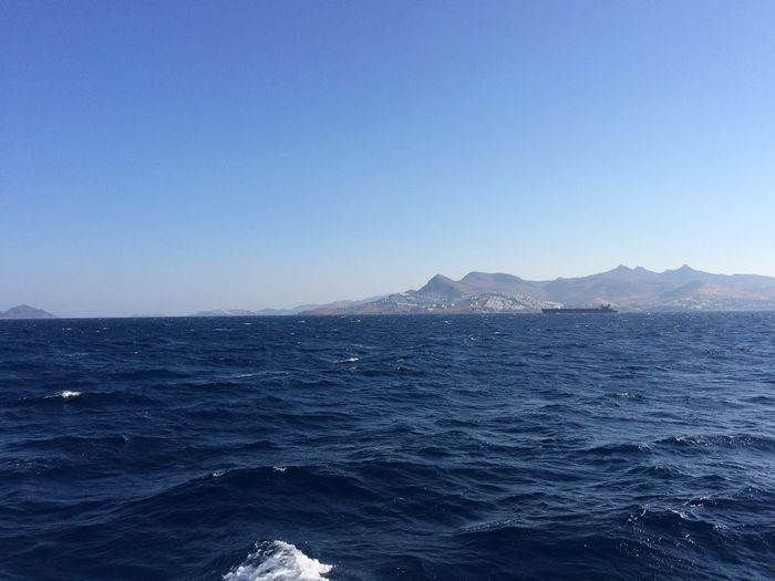 Sea Beauty In Nature Scenics Nature Tranquil Scene Clear Sky Blue Tranquility Copy Space Mountain Water No People Outdoors Day Mountain Range Sunlight Sky View Into Land Cargo Ship Ship Long Ship Greece