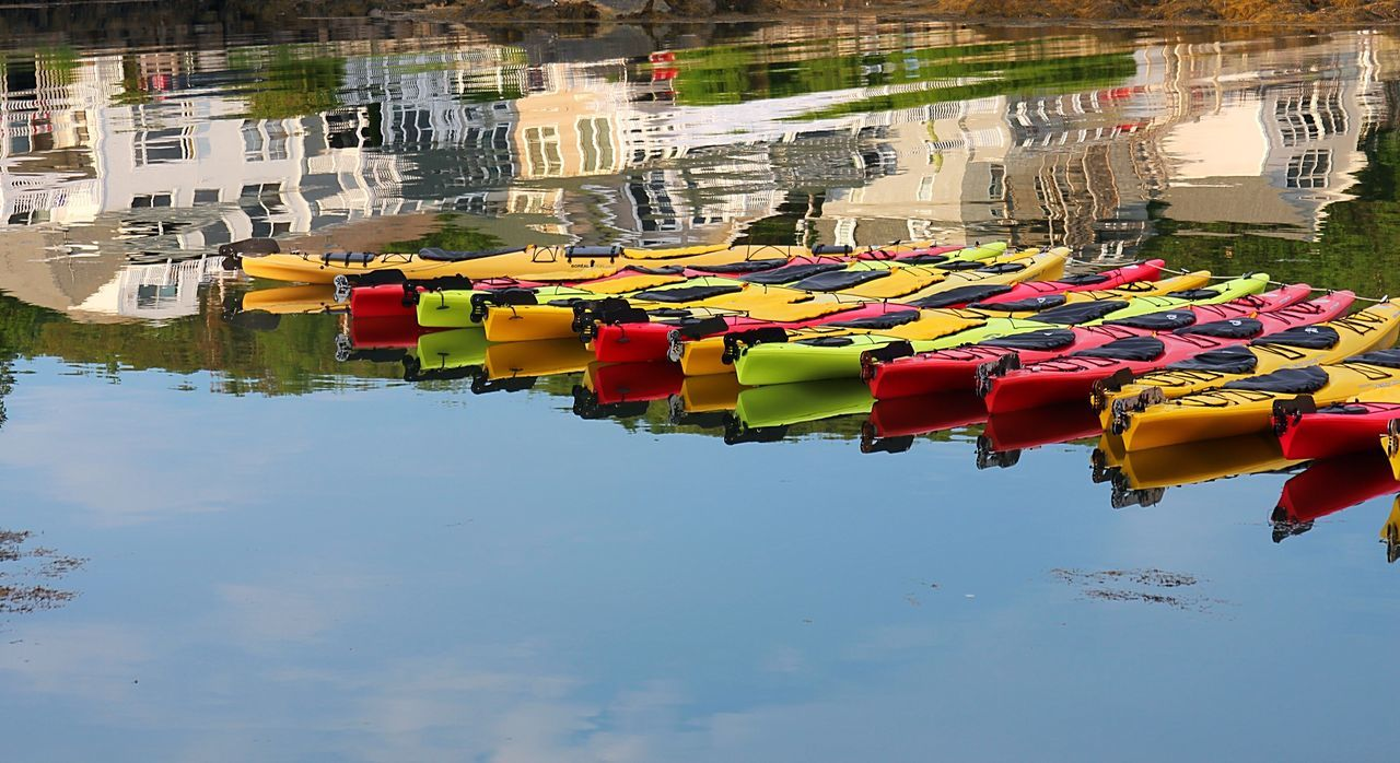multi colored, water, architecture, built structure, day, reflection, building exterior, no people, outdoors, large group of objects, moored, nautical vessel, nature, sky