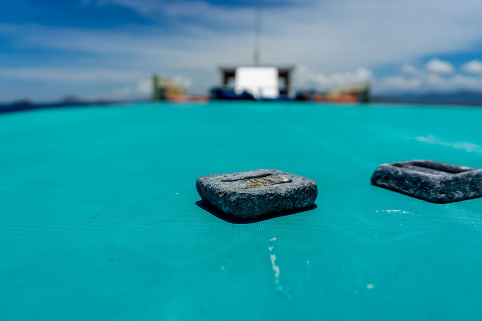 Scuba diving weights on a boat in Indonesia Boat Close-up Day Depth Of Field Diving Focus On Foreground INDONESIA Indonesia_photography Nature No People Outdoors SCUBA Scuba Diving Sea Sky Sunny Tarvel Travel Travel Destinations Travel Photography Traveling Travelling Travelphotography Weights