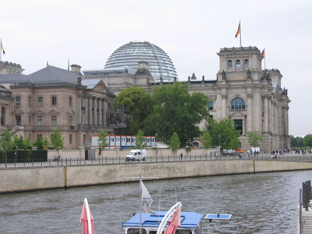 Architecture Building Exterior Built Structure Day Dome Flag Government History Nature No People Outdoors Patriotism Reichstagskuppel Sky Tourism Travel Travel Destinations Tree Water Waterfront