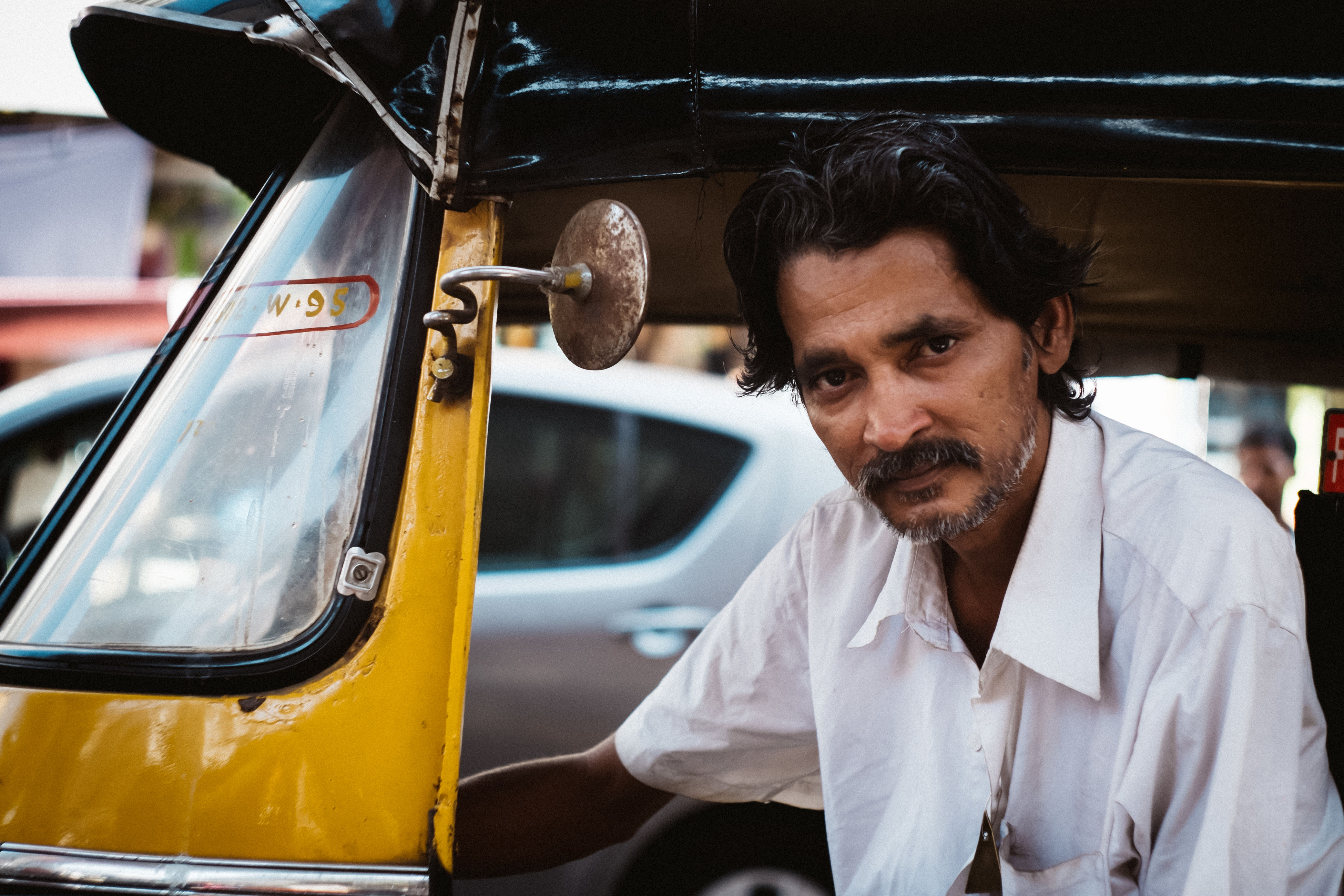 transportation, mode of transport, land vehicle, car, lifestyles, travel, men, vehicle interior, leisure activity, looking at camera, close-up, front view, young men, portrait, public transportation, focus on foreground, casual clothing, day