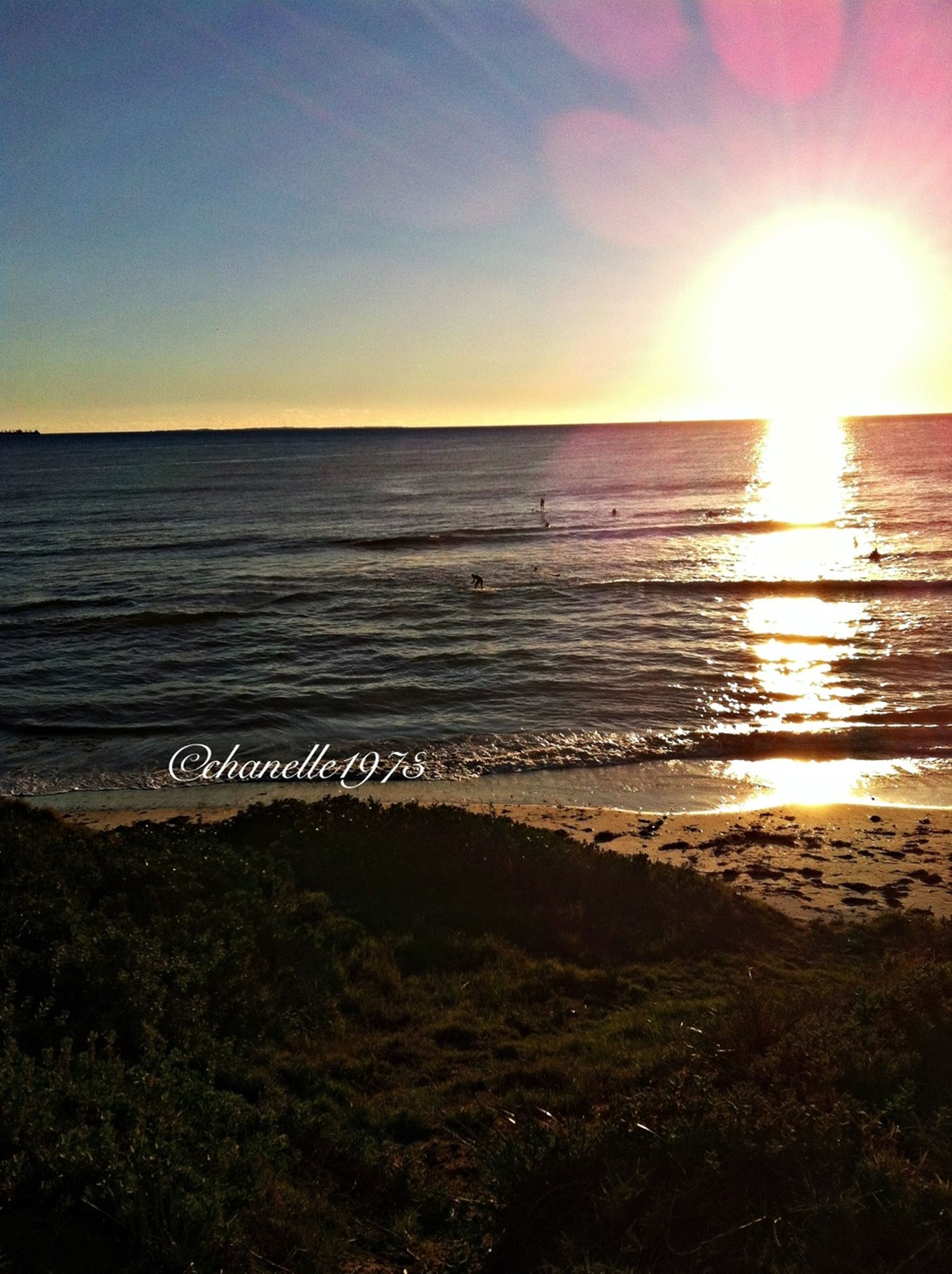 sea, sun, horizon over water, water, beach, sunset, tranquil scene, scenics, tranquility, shore, beauty in nature, sunlight, sand, nature, idyllic, sky, sunbeam, lens flare, clear sky, wave